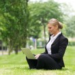 Businesswoman working outdoors on laptop — Stock Photo