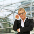 Proud business woman in glasses — Stock Photo