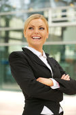 Happy businesswoman smiling in the city — Stock Photo