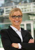 Beautiful businesswoman smiling with glasses — Stock Photo