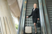 Businesswoman traveling with bags — Stock Photo