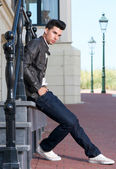 Male fashion model relaxing outdoors — Stock Photo
