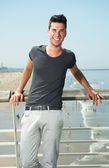 Attractive male smiling at the beach — Stock Photo