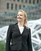 Portrait of a businesswoman smiling outdoors — Stok fotoğraf