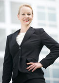 Confident business woman smiling outdoors — Stock Photo