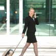 Businesswoman walking and talking in the city — Stock Photo