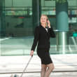Business woman walking and calling with mobile phone outdoors — Stock Photo #29687171