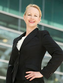 Portrait of a businesswoman smiling outdoors — Stock Photo