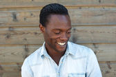 Cheerful african american man laughing — Stock Photo