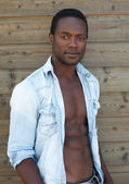 Attractive black man posing with open shirt — Stock Photo
