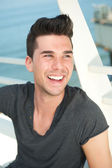 Attractive caucasian man laughing outdoors — Stock Photo