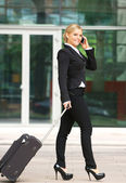 Attractive caucasian business woman talking on mobile phone — Stock Photo