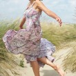 Beautiful middle aged woman dancing outdoors — Stock Photo