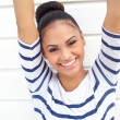 Beautiful young woman smiling with arms raised — Stock Photo