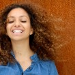 Stock Photo: Portrait of beautiful young womsmiling with curly hair