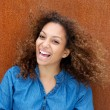 Cheerful young woman smiling with curly hair — Stock Photo #32004067