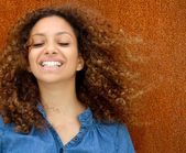 Portrait of a beautiful young woman smiling with curly hair — Stock Photo