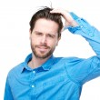 Confused male individual with hand in hair — Stock Photo