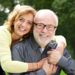Beautiful woman embracing handsome man — Stock Photo