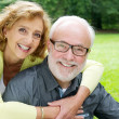 Happy older couple smiling and showing affection — Stock Photo
