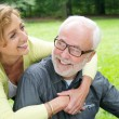 Happy older couple laughing outdoors — Stock Photo