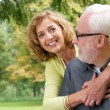 Portrait of a loving older couple smiling outdoors — Stock Photo