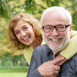 Happy older woman embracing smiling older man — Stock Photo