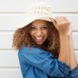 Pretty young woman wearing summer hat and laughing — Stock Photo