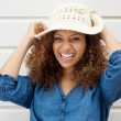 Cheerful carefree woman laughing and wearing summer hat — Stock Photo
