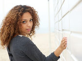 Attractive woman looking over shoulder — Stock Photo