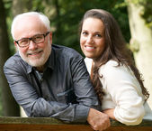 Mature father and young daughter smiling outdoors — Stock Photo