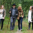 Father and mother walking with daughters in the woods — Stock Photo