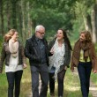 Happy family walking through the forest together — Stock Photo