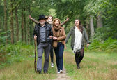 Happy family walking in the woods — Stock Photo