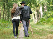 Father and daughter enjoying a walk in the woods — Stock Photo