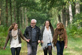 Happy family walking in the forest together — Stock Photo