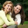 Portrait of a happy mother and daughter smiling outdoors — Foto Stock