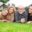 Portrait of a happy family smiling together outdoors — Stock Photo