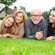 Stock Photo: Portrait of happy family smiling together outdoors