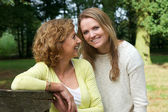 Portrait of mother and daughter smiling outdoors — Stock Photo