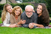 Close up portrait of a smiling family outdoors — Stock Photo