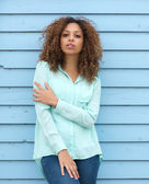 Female fashion model with curly hair standing outdoors — Stock Photo