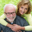 Portrait of a senior couple smiling together outdoors — Stock Photo
