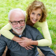 Happy senior caucasian couple smiling outdoors — Stock Photo #34293377