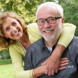 Portrait of a happy senior couple smiling outdoors — Stock Photo