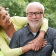 Happy senior man and beautiful older woman smiling together — Stock Photo #34293513