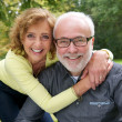 Portrait of a senior couple laughing together outdoors — Stockfoto