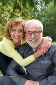 Portrait of a senior couple laughing together outdoors — Stock Photo