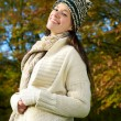 Happy young woman smiling outdoors in autumn — Stock Photo