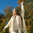 Cheerful woman laughing outdoors on a sunny fall day — Stock Photo